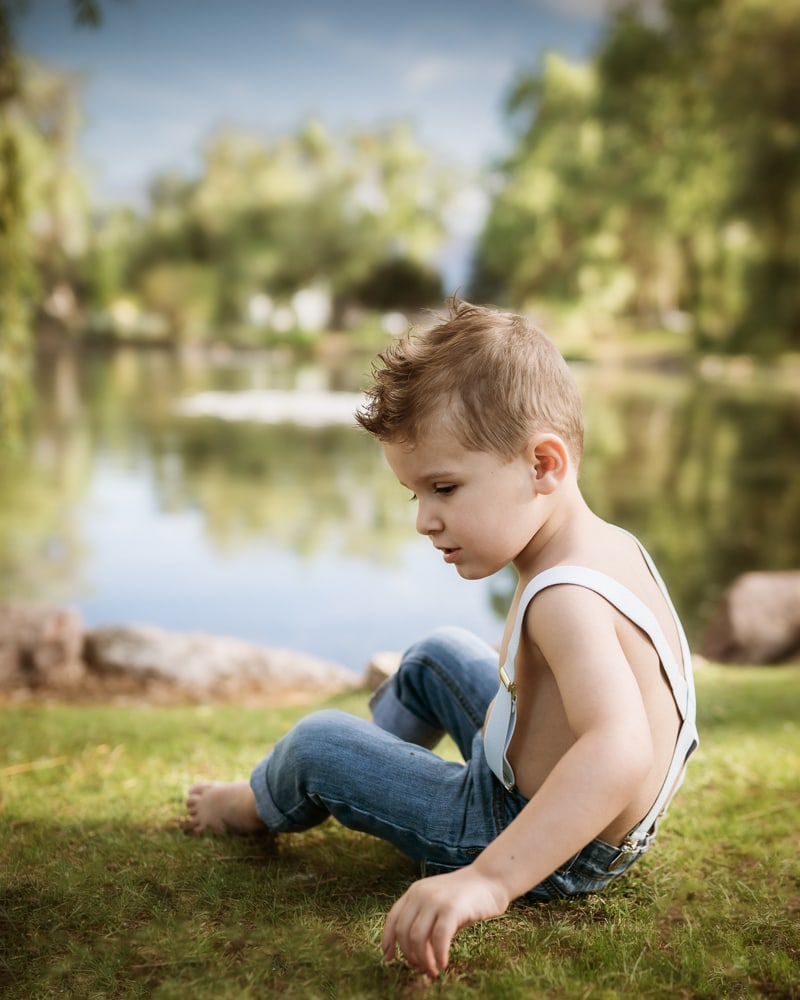 Denver Children's Photography, little boy in suspenders next to a lake