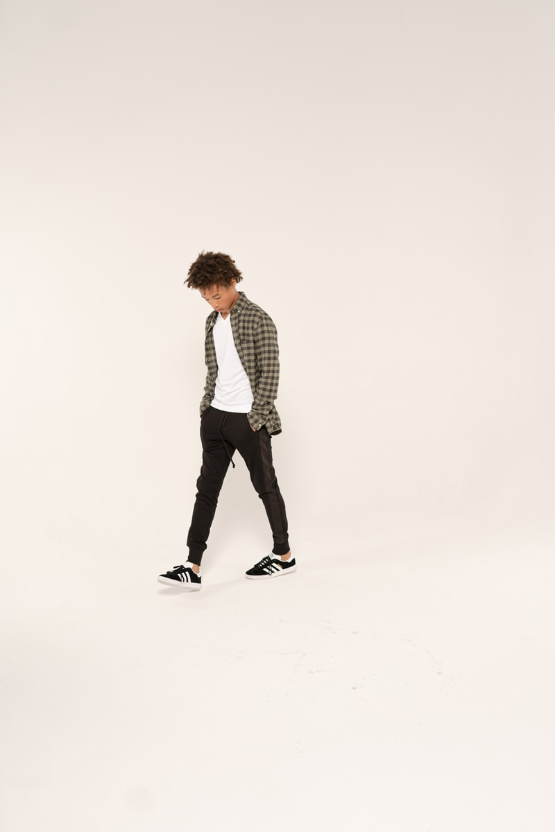 Denver Senior Photography, boy walking in a plaid shirt and dark pants