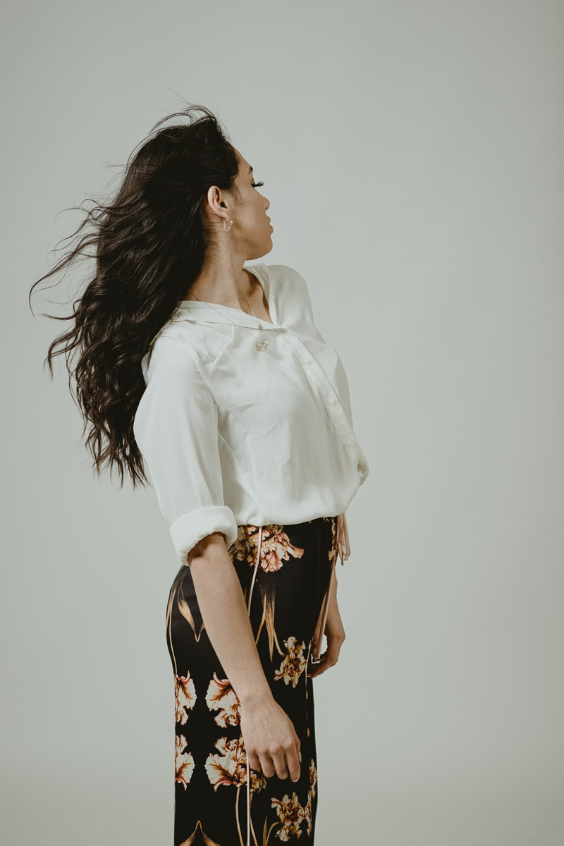 Denver Senior Photography, girl in cream top, looking over her shoulder