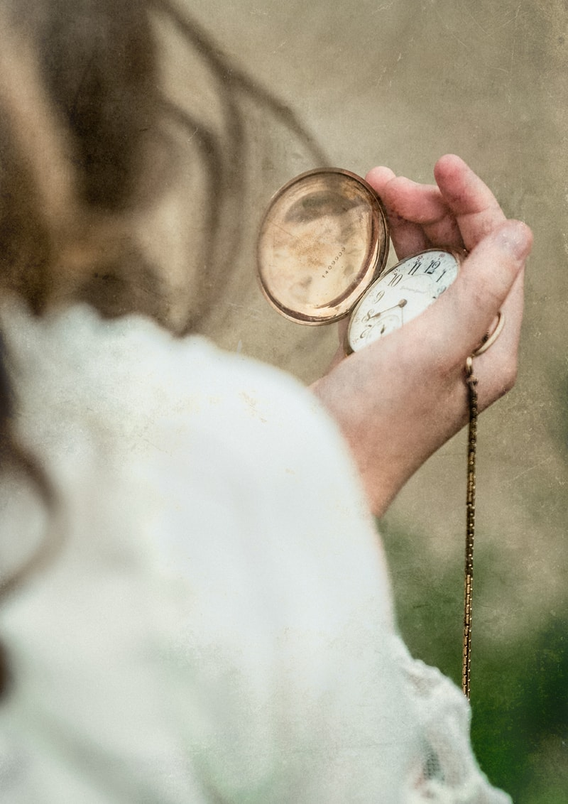 Denver Fine Art Photography, girl looking at a pocket watch