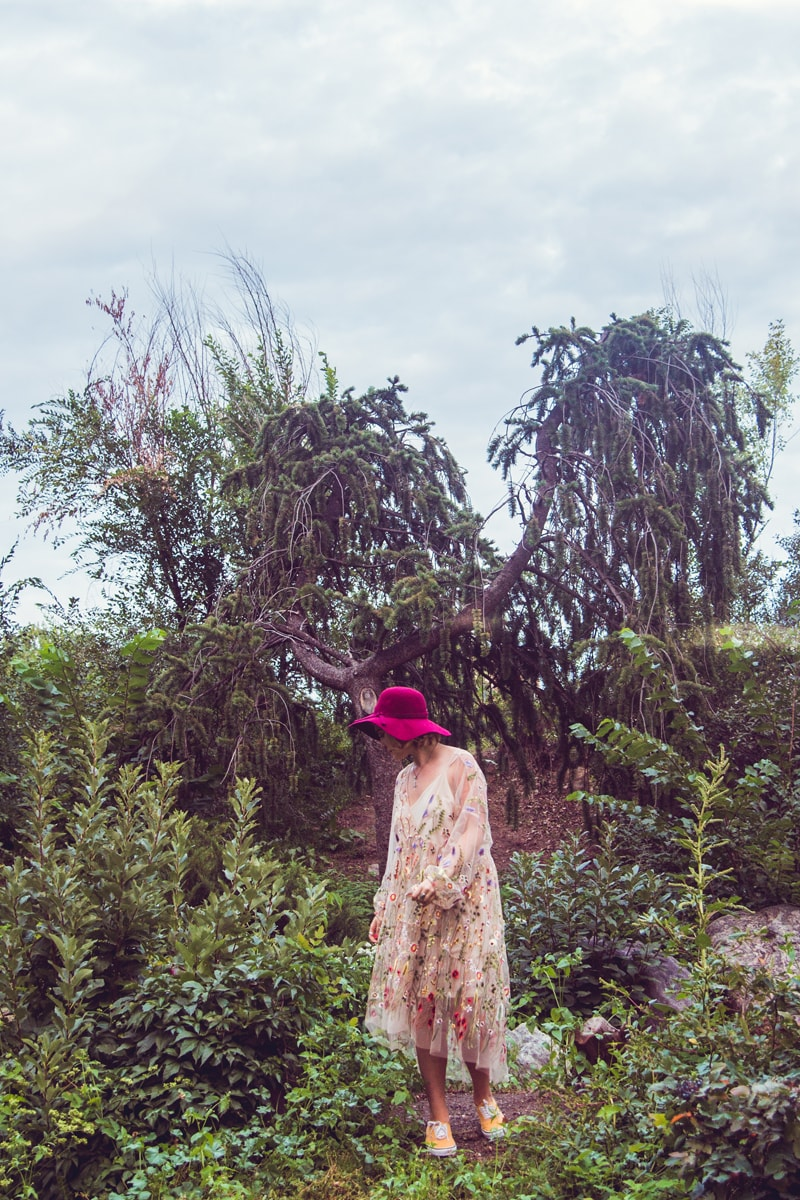 Denver Senior Photography, girl in red hat, standing in foliage