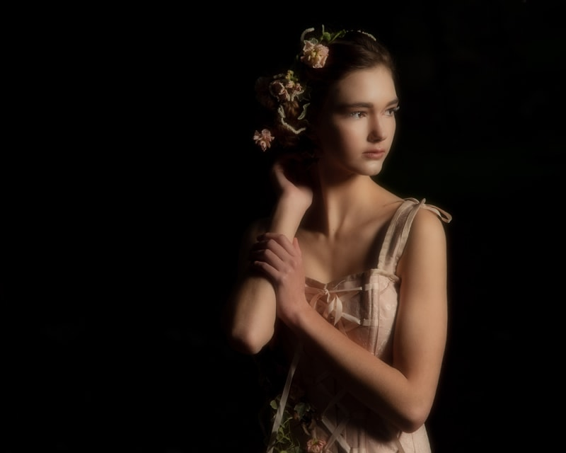 Denver Fine Art Photography, young woman with floral hair piece and black background