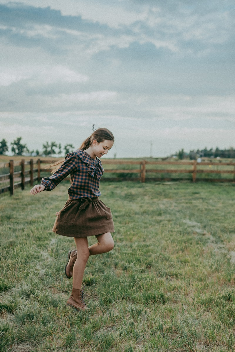 Denver Children's Photography, girl skipping in a field