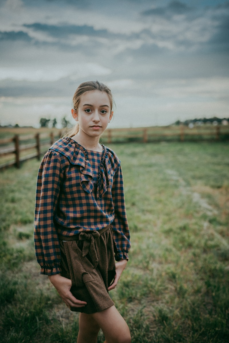 Denver Children's Photography, girl in plaid standing in the grass