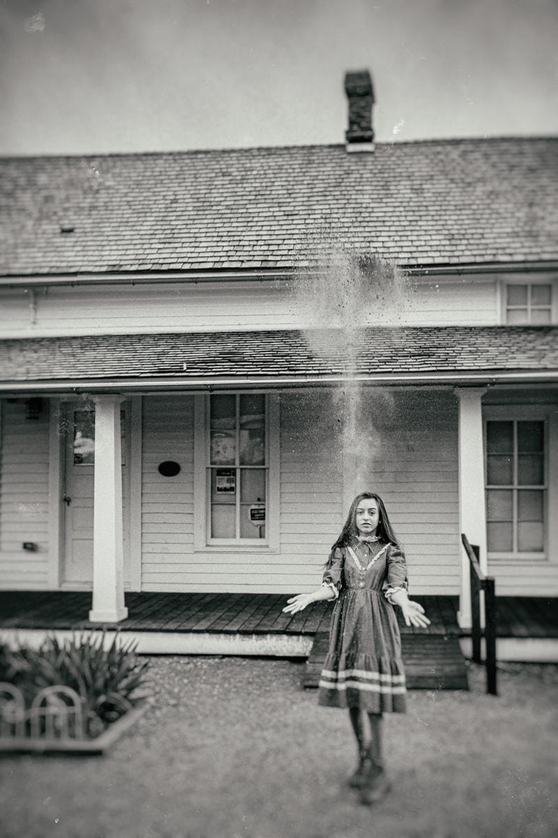 Denver Fine Art Photography, girl through dirt into the air