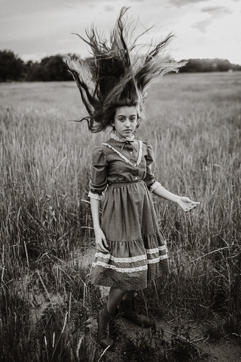 Denver Fine Art Photography, girl with her hair up in the air