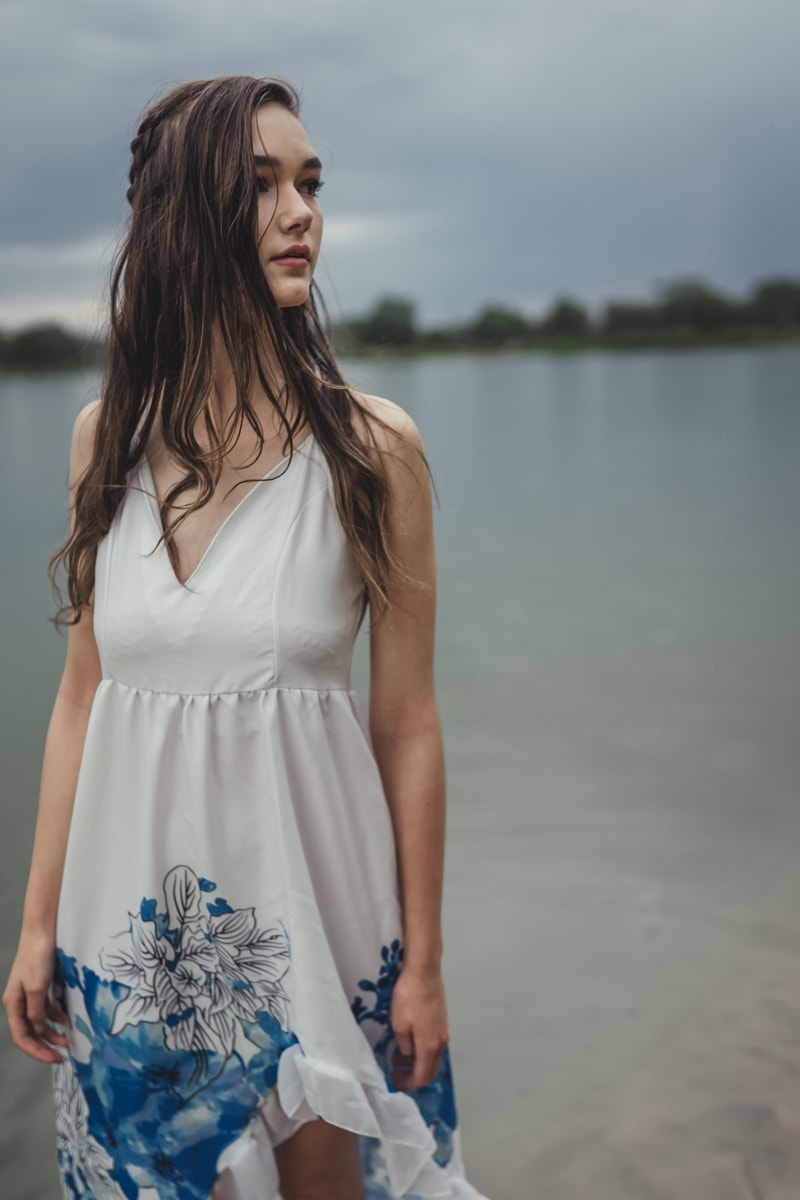Denver Senior Photography, girl next to lake in white and blue dress