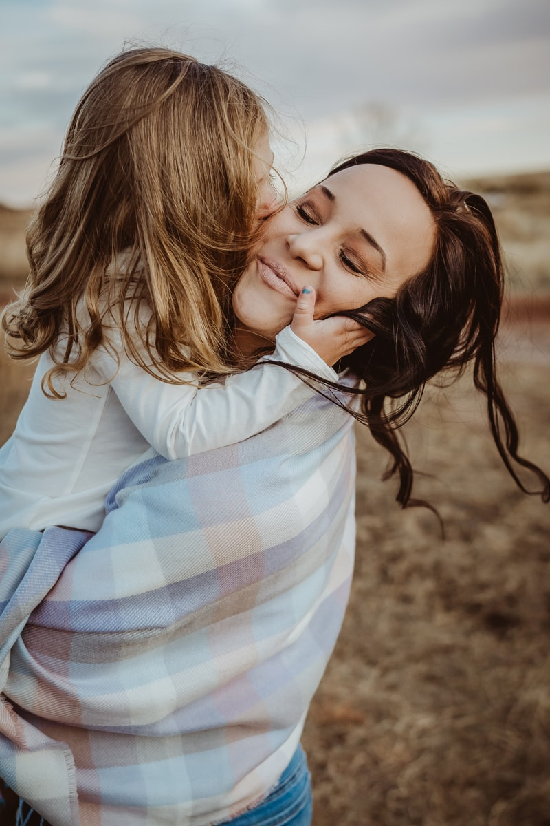 Denver Family Photography, daughter kissing mother's cheek
