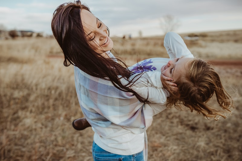 Denver Family Photography, mother spinning daughter around