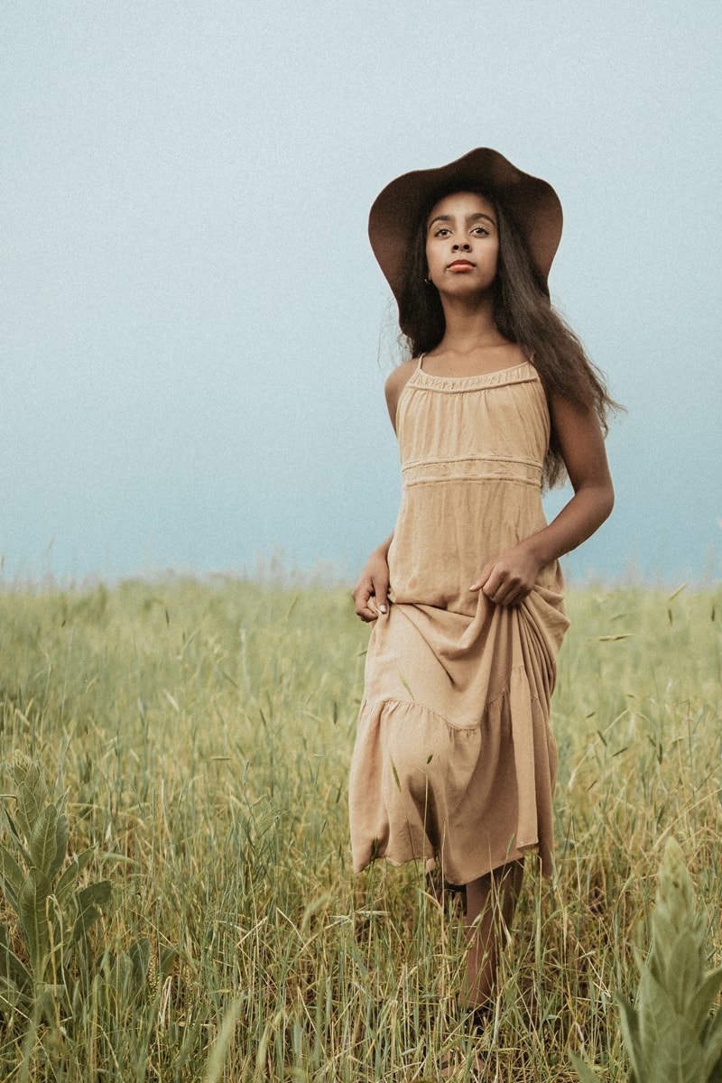 Denver Children's Photography, girl in wide hat standing in tall grass