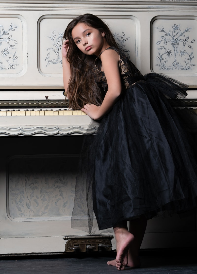 Denver Children's Photography, little girl leaning on a piano