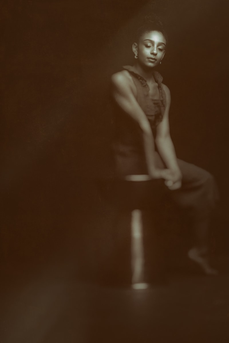 Denver Fine Art Photography, focused image of woman on a stool