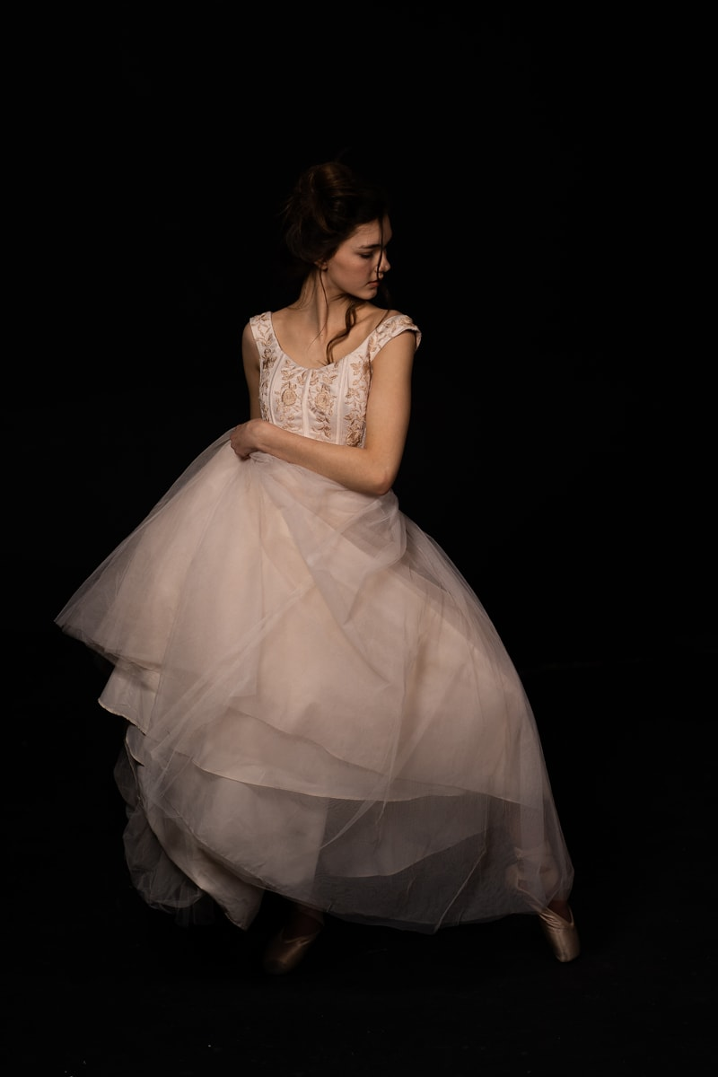 Denver Dance Photography, dancer in white holding her dress to her side