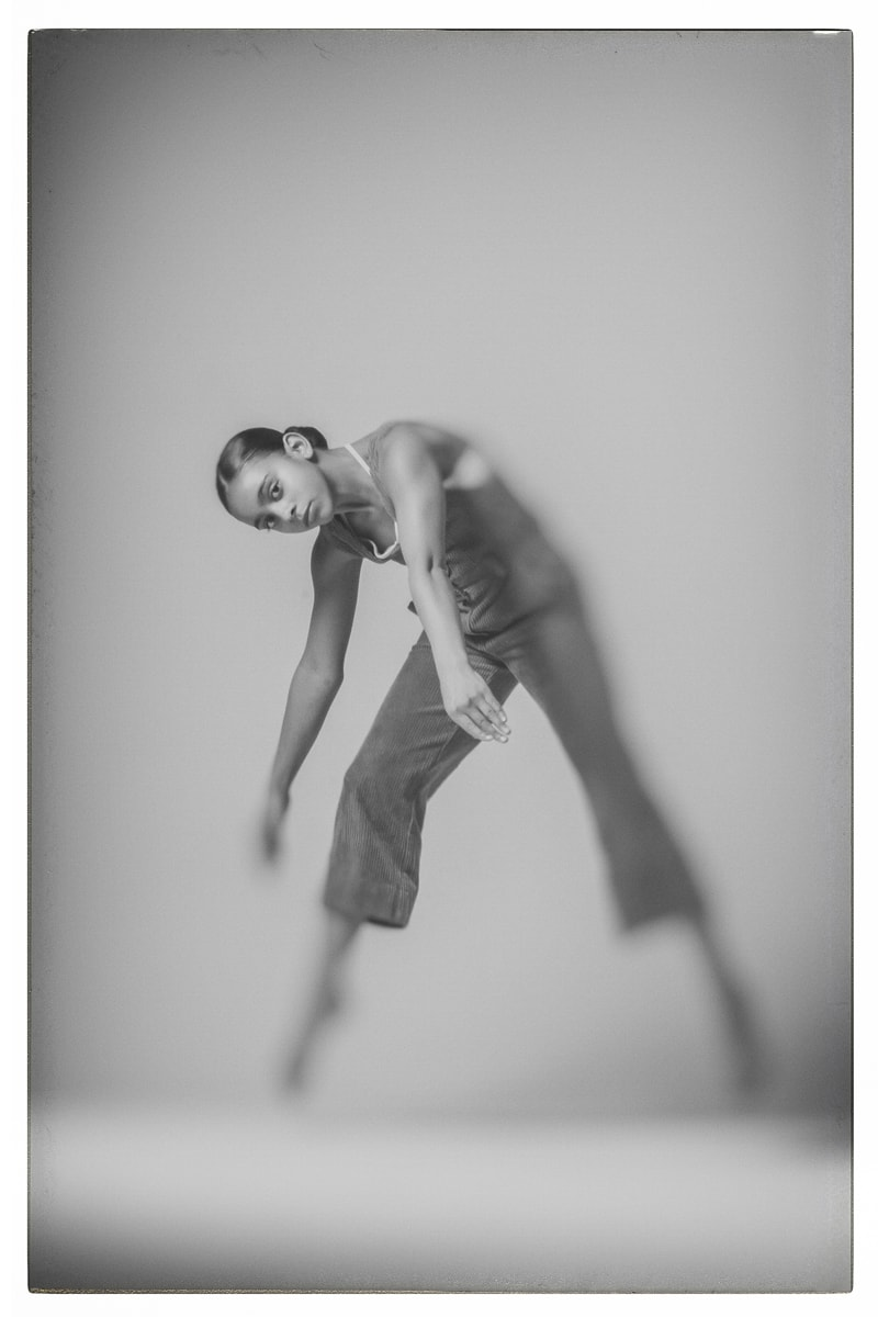 Denver Dance Photography, black and white of dancer leaning down