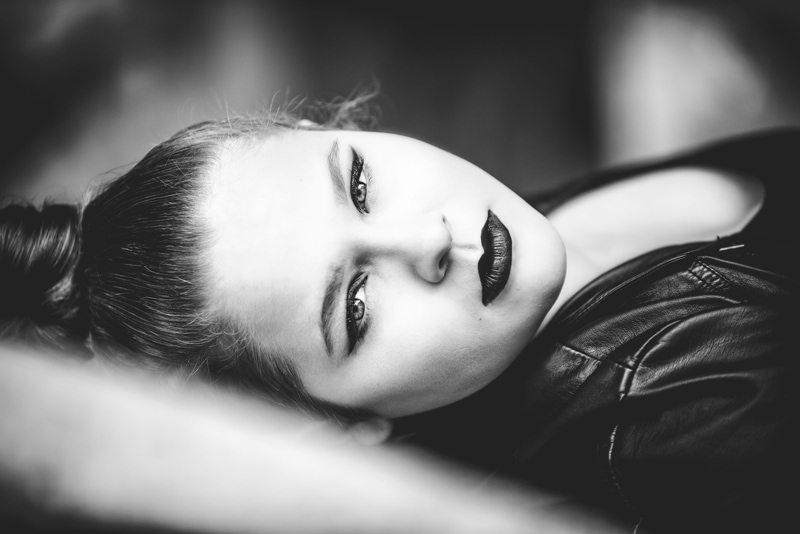 Denver Senior Photography, black and white close up of girl laying on her back
