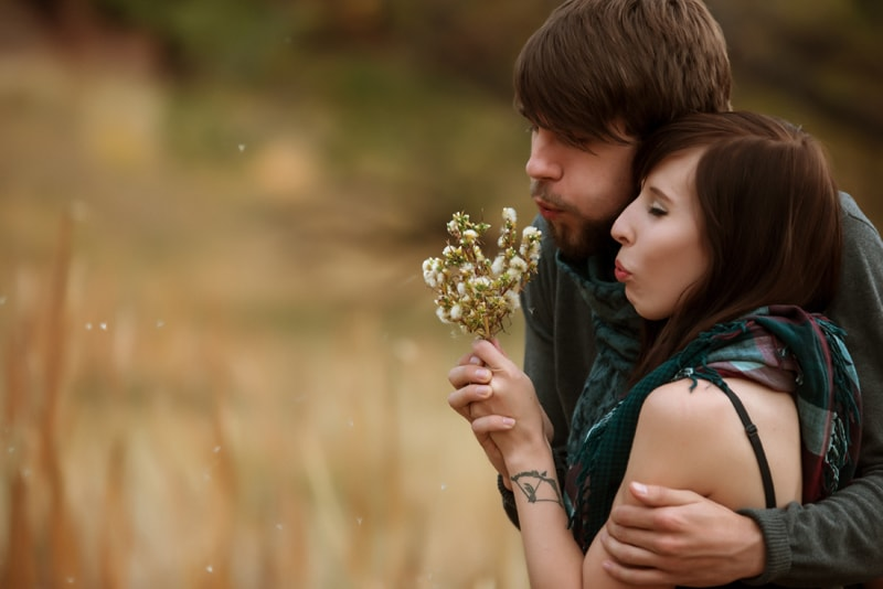 Denver Couples Photography, couple blowing a wildflower together