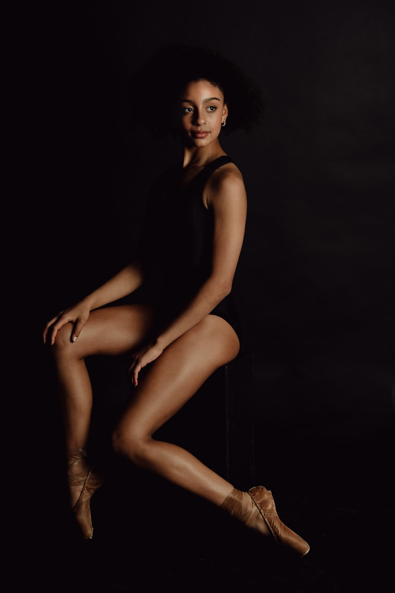 Denver Dance Photography, dancer sitting on stool