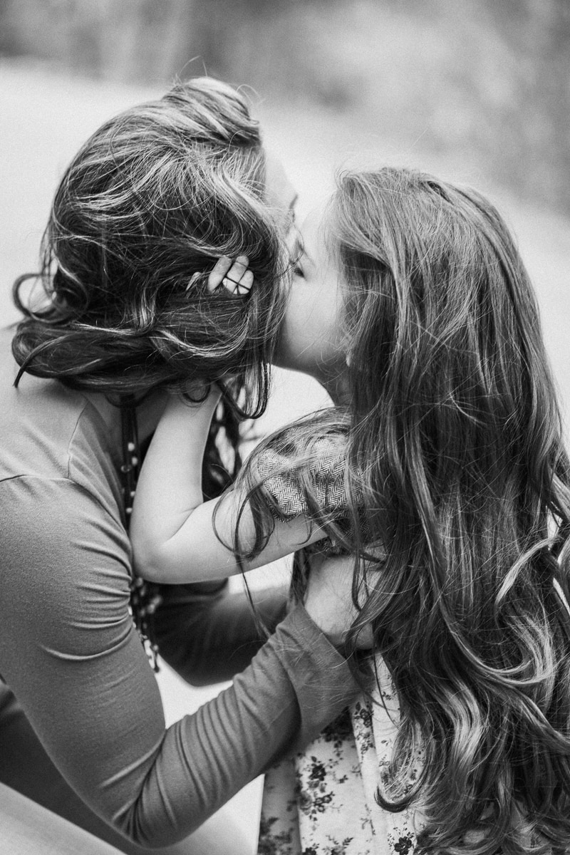 Denver Family Photography, black and white of daughter kissing mother's cheek