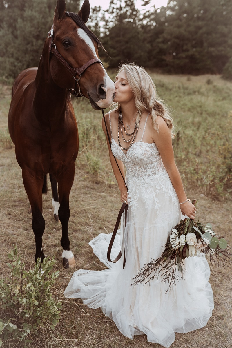 Denver Bridal Photography, bride giving a little kiss to a horse