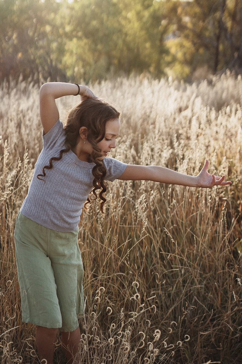 Denver Dance Photography, dancer with outstretched hand in tall grass