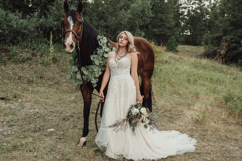 Denver Bridal Photography, bride standing next to a horse