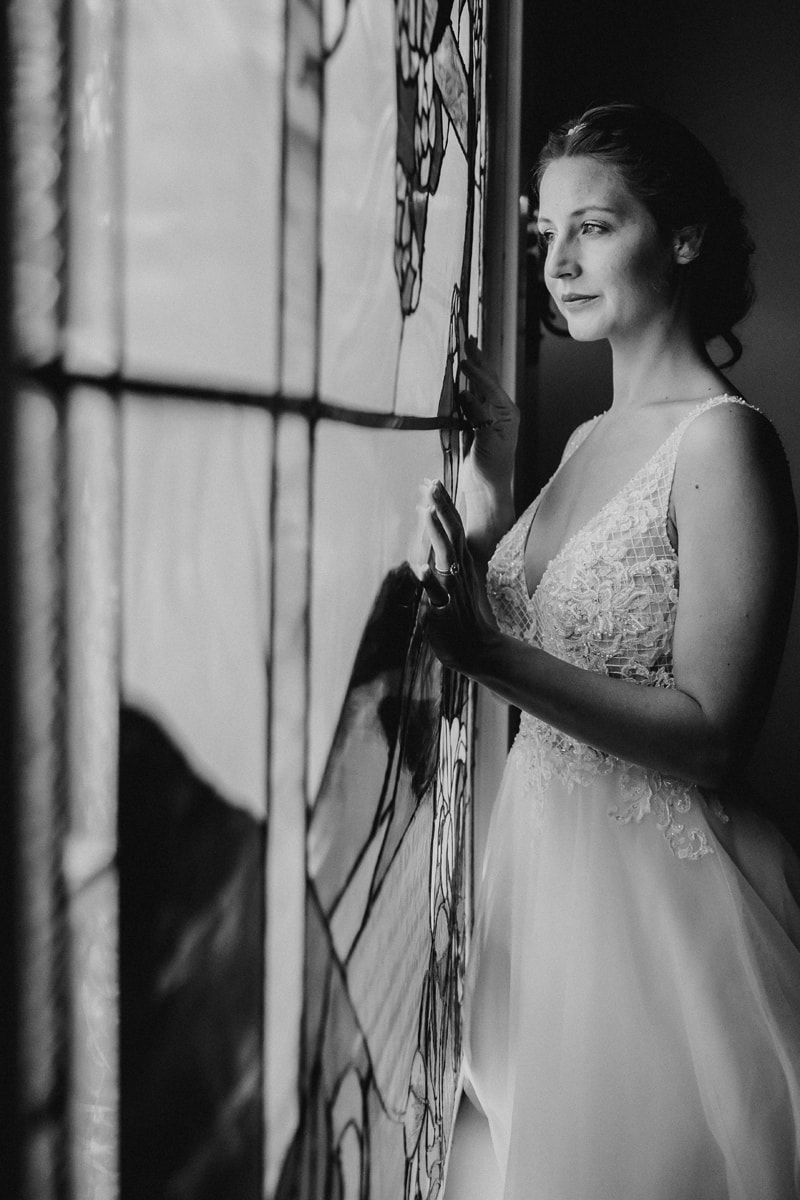 Denver Bridal Photography, black and white of bride looking out a window