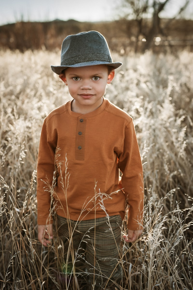 Denver Children's Photography, little boy in a field with a hat