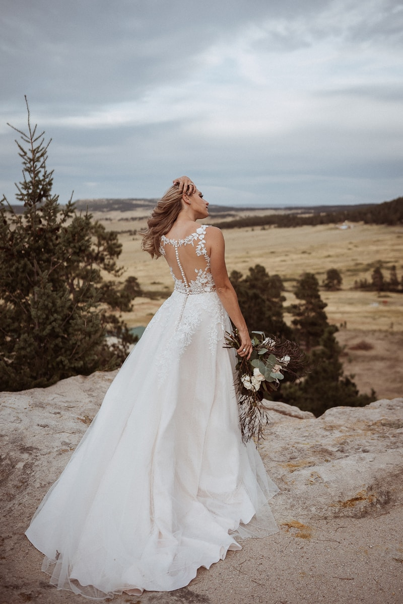Denver Bridal Photography, bride with her back to the camera and her hand moving through her hair