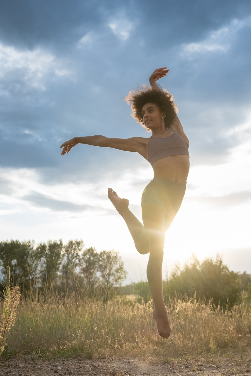 Denver Dance Photography, dancer jumping with sun in the background
