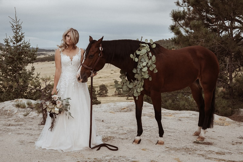 Denver Bridal Photography, bride holding on the reins of a horse