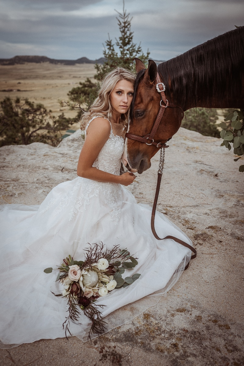 Denver Bridal Photography, bride resting her head against a horse