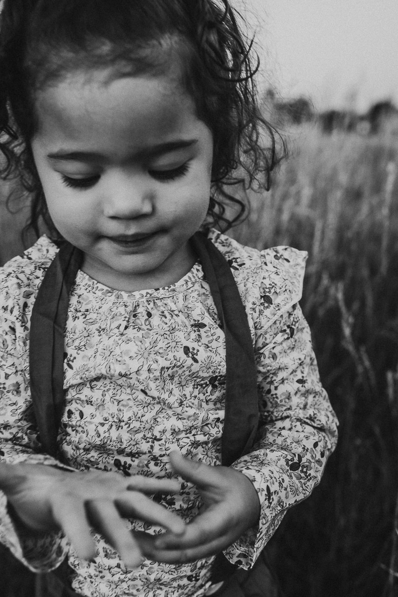 Denver Children's Photography, black and white of little girl looking at her hands