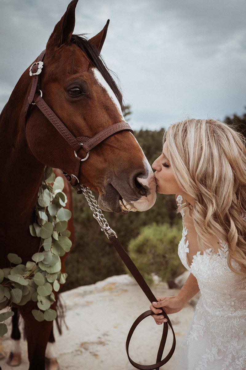 Denver Bridal Photography, close up of bride giving horse a kiss