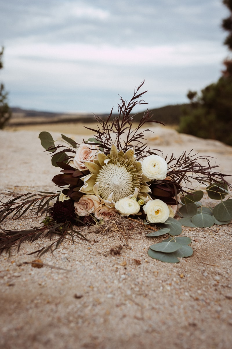 Denver Bridal Photography, bouquet laying on a dirt road