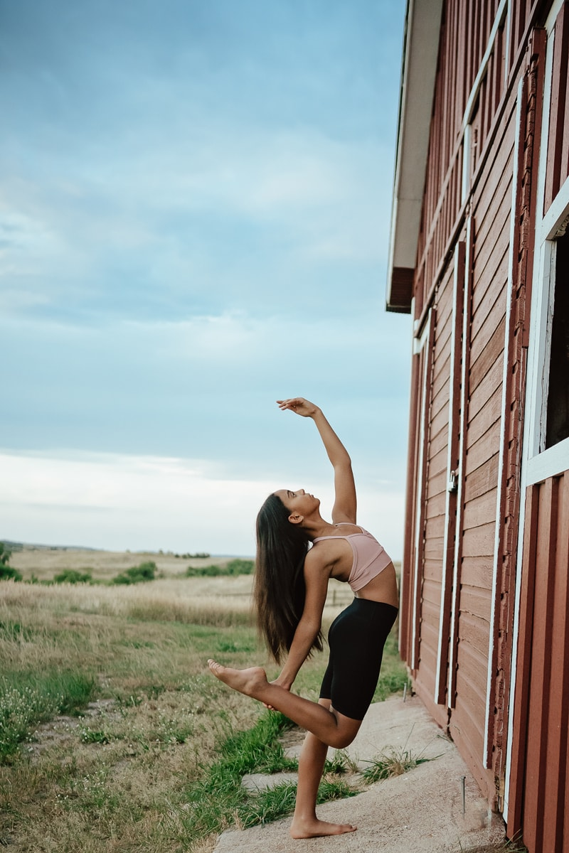 Denver Dance Photography, dancer posing next to a barn