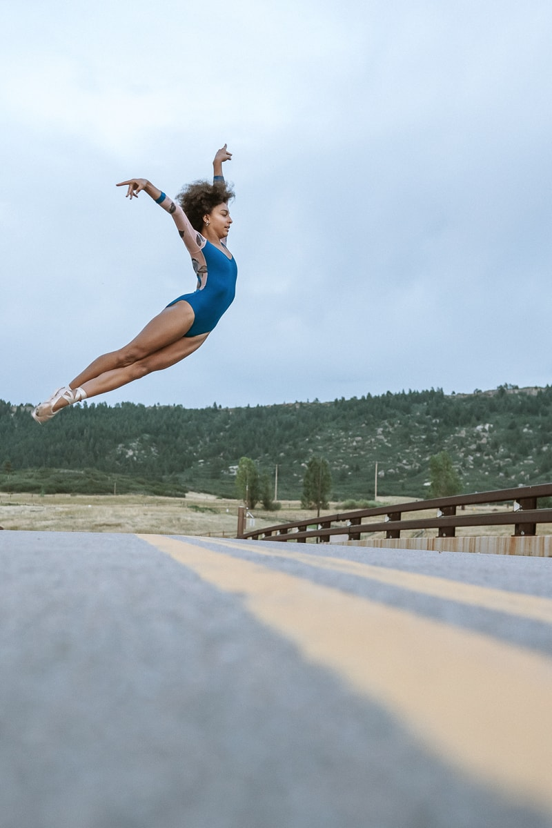 Denver Dance Photography, dancer jumping over a street